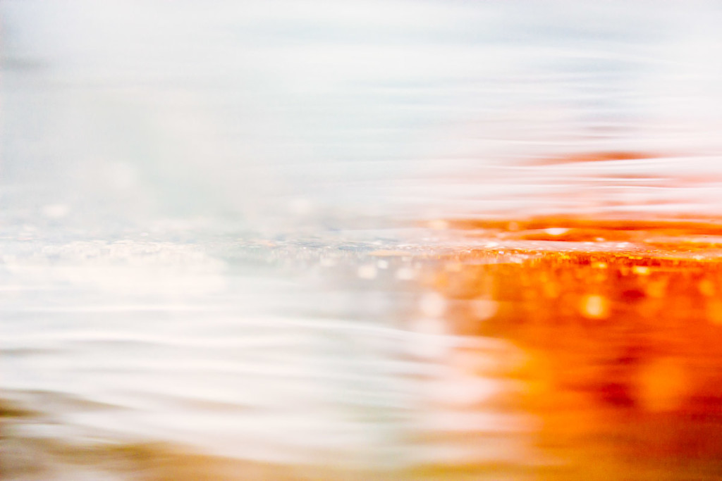 abstract image of puddle in white and orange