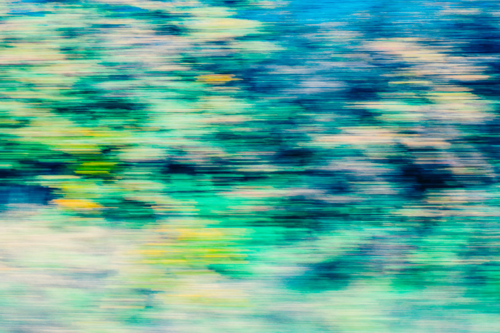 abstract colourful image of landscape taken in motion