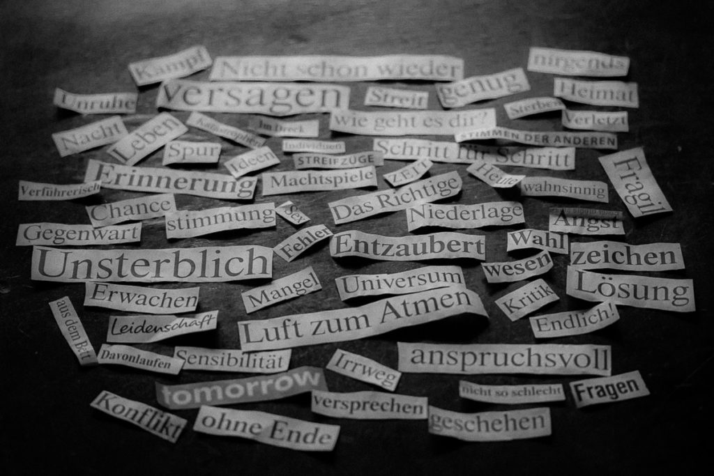 Collage of words cut out from a daily newspaper